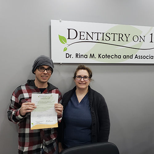 Happy family with Dr. Rina Kotecha, Patients who recently successfully completed Jeremy Bagnell at Dentistry on 10