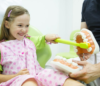 Smiling little girl in dentists chair