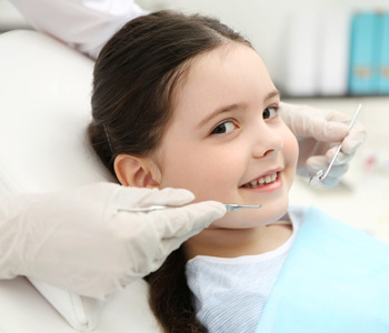 Cute little girl in the dentist chair