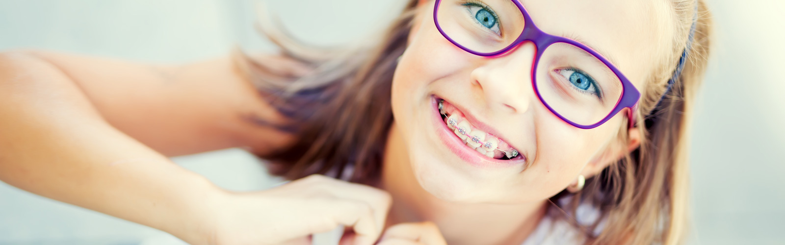 Smiling little girl with braces