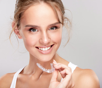 Woman holding invisible braces