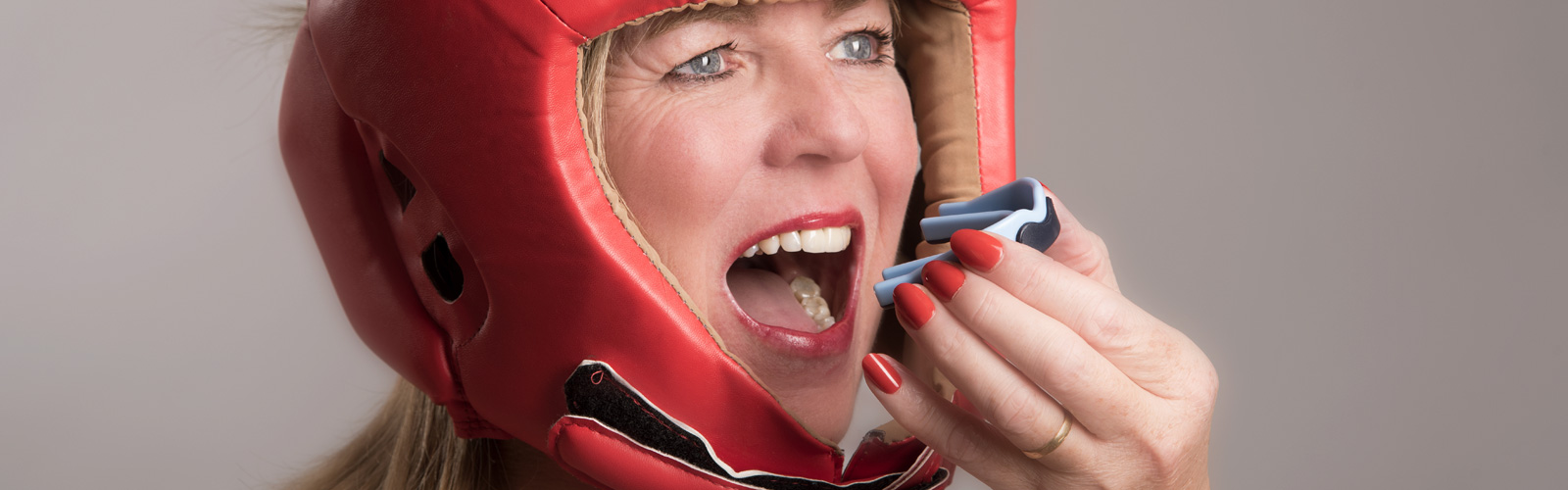 Female boxer with a mouthguards