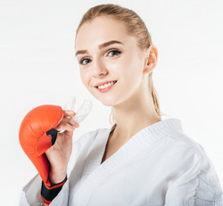 Girl with mouthguard in her hand